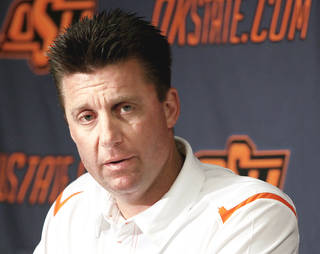 Oklahoma State coach Mike Gundy talks to the media Saturday in Stillwater. (Photo by John Clanton, The Oklahoman)