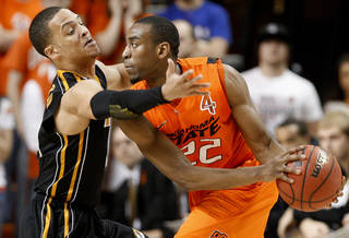 Oklahoma State's Markel Brown (22) looks to pass around Missouri's Michael Dixon (11) during an NCAA college basketball game between the Oklahoma State University Cowboys (OSU) and the Missouri Tigers (MU) at Gallagher-Iba Arena in Stillwater, Okla., Wednesday, Jan. 25, 2012. Photo by Bryan Terry, The Oklahoman