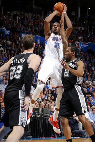 Oklahoma City's Kevin Durant (35) shoots the ball from between San Antonio's Tiago Splitter (22) and Kawhi Leonard (2) during an NBA basketball game between the Oklahoma City Thunder and the San Antonio Spurs at Chesapeake Energy Arena in Oklahoma City, Thursday, April 3, 2014. Oklahoma City won 106-94. Photo by Bryan Terry, The Oklahoman