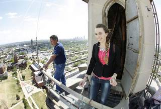 Oklahoman reporter Amanda Alfanos steps out onto the catwalk at the top of the 286 ft. tall Gold Star Memorial building on the campus of Oklahoma City University in Oklahoma City, OK, Thursday, April 14, 2011. By Paul Hellstern, The Oklahoman ORG XMIT: KOD PAUL HELLSTERN