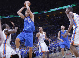Dirk Nowitzki (41) of Dallas puts up a shot over Oklahoma City's Kendrick Perkins (5) during game 3 of the Western Conference Finals of the NBA basketball playoffs between the Dallas Mavericks and the Oklahoma City Thunder at the OKC Arena in downtown Oklahoma City, Saturday, May 21, 2011. Photo by Chris Landsberger, The Oklahoman