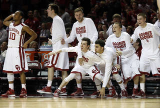 The Sooner bench reacts to play in the second half as the University of Oklahoma Sooners (OU) men defeat the Texas Longhorns (TU) 77-65 in NCAA, college basketball at The Lloyd Noble Center on Saturday, March 1, 2014 in Norman, Okla. Photo by Steve Sisney, The Oklahoman