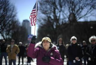 In this March 27, 2010, file photo Virginia Paiva, of Providence, protests against the health care reform bill recently signed into law by President Barack Obama during a rally in front of the Statehouse in Providence, R.I. (AP Photo/Gretchen Ertl, File)