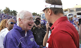 Bob Stoops shakes hands with Kansas State coach Bill Snyder after the college football game between the University of Oklahoma Sooners (OU) and the Kansas State University Wildcats (KSU) at Bill Snyder Family Stadium on Saturday, Oct. 29, 2011. in Manhattan, Kan. Photo by Chris Landsberger, The Oklahoman ORG XMIT: KOD