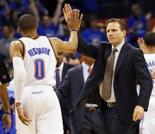 NBA BASKETBALL: Oklahoma City's Russell Westbrook (0) and coach Scott Brooks high-five during a timeout in the second half of Game 2 in the first round of the NBA playoffs between the Oklahoma City Thunder and the Houston Rockets at Chesapeake Energy Arena in Oklahoma City, Wednesday, April 24, 2013. Oklahoma City won, 105-102. Photo by Nate Billings, The Oklahoman