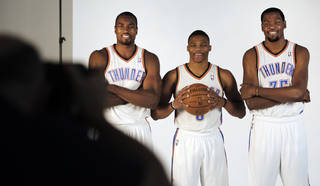 Serge Ibaka, Russell Westbrook and Kevin Durant pose for photos during media day with the Oklahoma City Thunder in Oklahoma City, Thursday September 27, 2013. Photo By Steve Gooch, The Oklahoman