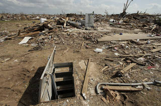 In this 2013 file photo, an underground shelter is seen near tornado rubble in Moore, OK. AP Photo Charlie Riedel - AP