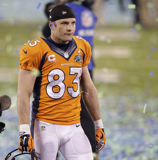 Broncos receiver and former Heritage Hall star Wes Welker walks off the field after losing Super Bowl XLVIII. The Seahawks won 43-8.AP Photo