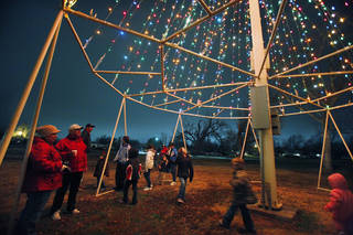 People gather under the lighted tree at the annual Christmas Tree Lighting Celebration at Andrews Park in Norman in 2011. Photo by Steve Sisney, The Oklahoman Archives