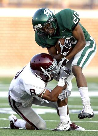 Edmond Santa Fe's Cameron Westbrook tries to get by Edmond Memorial's Devin Cossman during the high school football game between Edmond Santa Fe and Edmond Memorial at Wantland Stadium in Edmond, Okla., Friday, Sept. 2, 2011. Photo by Sarah Phipps, The Oklahoman