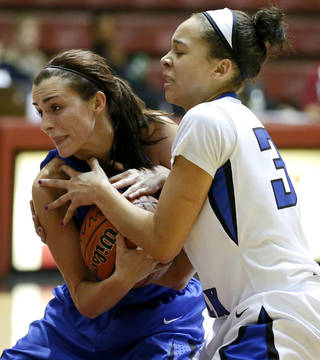 Harrah's Allie Holcombe, left, fights with Deer Creek's Ashley Gibson for the ball during their girls basketball game in the Bethany Classic tournament at the Sawyer Center in Bethany, Friday, Jan. 11, 2013. Photo by Bryan Terry, The Oklahoman