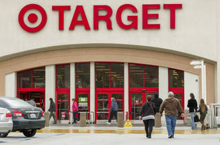Shoppers arrive at a Target store in Los Angeles . AP File Photo Damian Dovarganes - AP