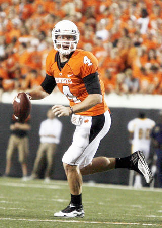OSU quarterback Brandon Weeden is still getting used to new offensive coordinator Dana Holgorsen's system. PHOTO BY SARAH PHIPPS, THE OKLAHOMAN
