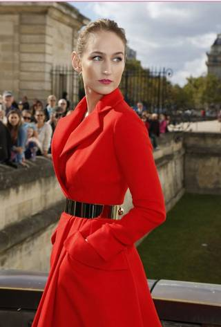 During Paris Fashion Week in late September, Sobieski was once again turning heads with her slightly offbeat, chic fashion sense. She made an appearance at the Christian Dior show in a red wool coat, bulky metallic belt and demure mauve heels.