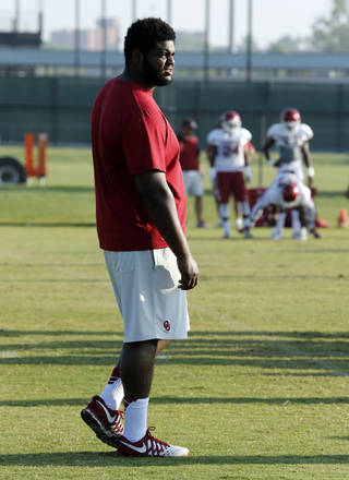 Defensive tackle Jordan Phillips is sidelined during the University of Oklahoma Sooners (OU) football practice at the rugby fields in Norman, Okla., on Tuesday, Aug. 5, 2014. Photo by Steve Sisney, The Oklahoman