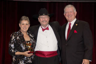 Donna and Larry Shipman with Sport Clips Founder and Chief Executive Officer Gordon Logan (center.) - PROVIDED