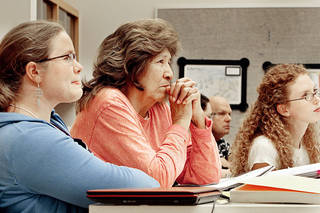 Linguistic expert Libby Tatz, left, and workshop participant Cheyenne Joyce Twins listen to a presentation at the Oklahoma Breath of Life language preservation short course at the Sam Noble Oklahoma Museum of Natural History in Norman. PHOTOS BY STEVE SISNEY, THE OKLAHOMAN
