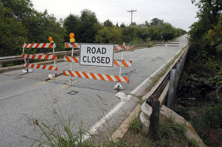 Sooner Road, between Covell and Coffee Creek roads in Edmond, is closed because of erosion of the timber supports. Design work on the repairs has started. PHOTO BY PAUL HELLSTERN, THE OKLAHOMAN