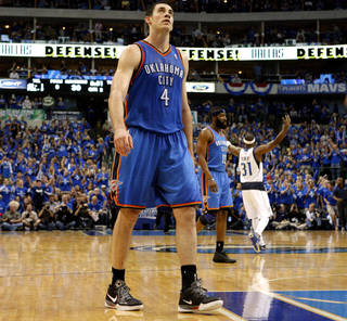 Oklahoma City's Nick Collison (4) walks back to the bench during game 1 of the Western Conference Finals in the NBA basketball playoffs between the Dallas Mavericks and the Oklahoma City Thunder at American Airlines Center in Dallas, Tuesday, May 17, 2011. Photo by Bryan Terry, The Oklahoman ORG XMIT: KOD