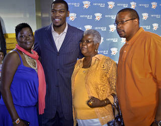 Kevin Durant poses for a photo with his mother Wanda Pratt, left, grandmother Barbara Davis and father Wayne Pratt after the press conference to officially announce Durant's five-year contract extension. PHOTO BY CHRIS LANDSBERGER, THE OKLAHOMAN