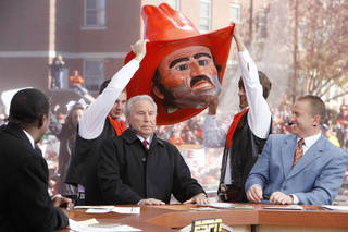 Co-hosts Desmons Howard (left) and Kirk Herbstreit laugh as Lee Corso dons the head of OSU mascot Pistol Pete, during Saturday's ESPN College Gameday broadcast in Stillwater, OK, Saturday, Nov. 27, 2010. By Paul Hellstern, The Oklahoman ORG XMIT: KOD