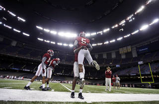Alabama head coach Nick Saban, right, watches drillsduring NCAA college football practice at the Superdome in New Orleans, Saturday, Dec. 28, 2013. Alabama takes on Oklahoma in the Sugar Bowl on Thursday, Jan. 2, 2013. (AP Photo/Gerald Herbert)