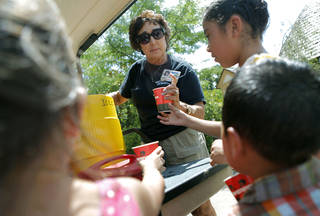 HEAT / SUMMER WEATHER / CHILD / CHILDREN / KIDS: Pam Allen, an employee at the zoo, passes out free ice and water to Stephanie Hernandez and her family during a hot day at the Oklahoma City Zoo in Oklahoma City on Thursday, July 21, 2011. Photo by John Clanton, The Oklahoman ORG XMIT: KOD