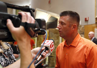 Oklahoma State head football coach Mike Gundy talks to the media during the Oklahoma State Caravan National Cowboy & Western Heritage in Oklahoma City, Tuesday, Aug. 7, 2012. Photo by Sarah Phipps, The Oklahoman