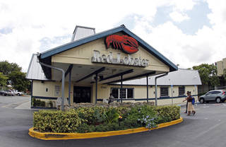 A Red Lobster restaurant in Hialeah, Fla. Darden Restaurants said it entered an agreement to sell its Red Lobster chain to investment firm Golden Gate Capital in a $2.1 billion cash deal. AP File Photo Alan Diaz - AP