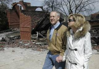 Oklahoma Gov. Brad Henry, left, and his wife, Kim Henry, right, tour homes damaged and destroyed by fire in Midwest City, Okla., Friday, April 10, 2009. (AP Photo/Sue Ogrocki)