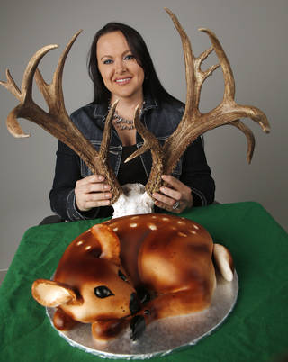 Linet Navarro, deer hunter and baker with antler rack and doe-shaped cake in studio Friday, November 30, 2012. Photo by Doug Hoke, The Oklahoman