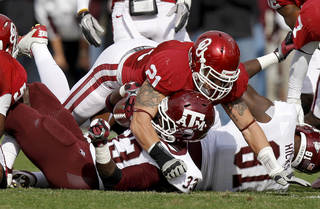 Oklahoma's Tom Wort (21) brings down Texas A&M's Christine Michael (33)during the college football game between the Texas A&M Aggies and the University of Oklahoma Sooners (OU) at Gaylord Family-Oklahoma Memorial Stadium on Saturday, Nov. 5, 2011, in Norman, Okla. Oklahoma won 41-25. Photo by Bryan Terry, The Oklahoman