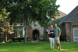 Tony Trammell and his wife, Lauren, outside their home in Edmond, Okla. Nick Oxford for The New York Times