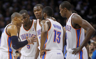 From left, Oklahoma City's Russell Westbrook (0), Kendrick Perkins (5), Kevin Durant (35), James Harden (13), and Serge Ibaka (9) gather during the NBA basketball game between the Denver Nuggets and the Oklahoma City Thunder in the first round of the NBA playoffs at the Oklahoma City Arena, Wednesday, April 27, 2011. Photo by Bryan Terry, The Oklahoman.