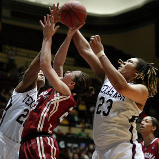 OU's Whitney Hand (25) tries to get to the basket between Texas A&M's Tyra White (20) and Danielle Adams (23) during the women's college basketball Big 12 Championship tournament game between the University of Oklahoma and Texas A&M in Kansas City, Mo., Friday, March 11, 2011. Photo by Bryan Terry, The Oklahoman