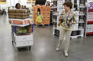 In this June 2, 2011 photo, shoppers Leslie Corridon, left, and Leslie Christon walks the aisles at a Sam's Club store in Rogers, Ark. (AP Photo/Danny Johnston)
