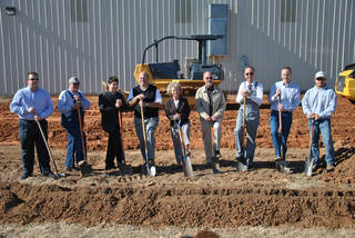 (Left to Right): Shawnee City Manager Brian McDougal, Shawnee City Commissioner James Harrod, State Rep. Justin Wood, Mayor of Shawnee Wes Mainord, Shawnee City Commissioner Linda Agee, Architect John Patterson, President & Owner Jim Antosh, Vice President David Antosh, Contractor Brandon Columbus attend Thursday's groundbreaking at Round House in Shawnee. - PROVIDED
