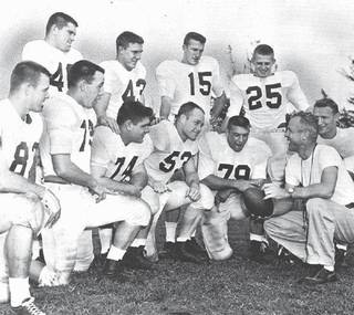 Former OU coach Bud Wilkinson talks with players on Dec. 29, 1955, as the team prepared for the Orange Bowl. Players are, top row from left, Robert Burris, Billy Pricer, Jim Harris and Tommy McDonald. On the bottom row are John Bell, Edmon Gray, Cecil Morris, Jerry Tubbs, Bo Bolinger, Wilkinson and Calvin Woodworth. The team was part of OU's 47-game winning streak, which stretched from 1953-57. - OKLAHOMAN ARCHIVE OKLAHOMAN ARCHIVE