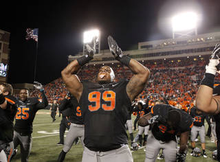 Oklahoma State's Richetti Jones (99) celebrates the Cowboys' win over Kansas State during a college football game between the Oklahoma State University Cowboys (OSU) and the Kansas State University Wildcats (KSU) at Boone Pickens Stadium in Stillwater, Okla., Saturday, Nov. 5, 2011. Photo by Sarah Phipps, The Oklahoman