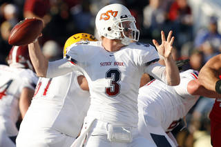 South Team quarterback Brandon Weeden (3) of Oklahoma State looks to throw during the first quarter of the Senior Bowl NCAA college football game at Ladd-Peebles Stadium, Saturday, Jan. 28, 2012, in Mobile, Ala. (AP Photo/Mobile Press-Register, Mike Kittrell) MAGS OUT ORG XMIT: ALMOP202