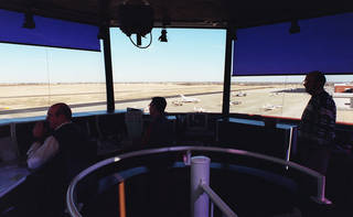 FILE PHOTO: Air traffic controllers inside Norman's Max Westheimer Airport, one of six towers in Oklahoma set to close due to FAA budget cuts. ROGER KLOCK