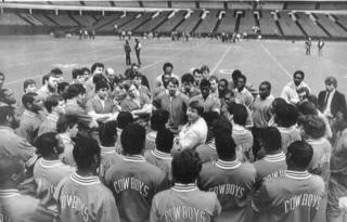 Oklahoma State football players gather around Jimmy Johnson for some instructions following a practice before the Bluebonnet Bowl at the Astrodome. This was Johnson's last year to coach the Cowboys. OKLAHOMAN ARCHIVE PHOTO JIM ARGO