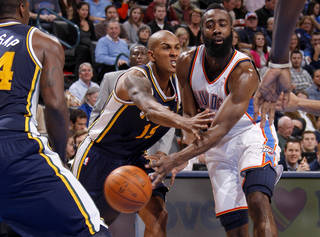 NBA BASKETBALL: Oklahoma City's James Harden (13) passes the ball around Utah's Raja Bell (19) during an NBA game between the Oklahoma City Thunder and the Utah Jazz at Chesapeake Energy Arena in Oklahoma CIty, Tuesday, Feb. 14, 2012. Photo by Bryan Terry, The Oklahoman