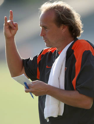 OSU Offensive Coordinator Dana Holgorsen calls a play during the Cowboys' practice on the campus of Oklahoma State University in Stillwater, Okla., on Sunday, August 8, 2010. Photo by John Clanton, The Oklahoman