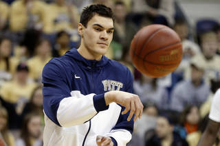 Pittsburgh's Steven Adams passes the ball during team warmup before the NCAA college basketball game against Villanova on Sunday, March 3, 2013 in Pittsburgh. Reports said Adams was injured in practice on Saturday and may not play against Villanova.(AP Photo/Keith Srakocic)