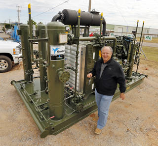 Compressco manager of Strategy Development Tommy Johnson shows one of the company's compressors on Wednesday, Oct. 16, 2013, in Oklahoma City, Okla. Photo by Steve Sisney, The Oklahoman