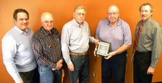 C.J. Hansen, holding plaque, was honored for 28 years on the Canadian Valley Technology Center Foundation board. Also pictured are Greg Winters, Canadian Valley superintendent; Marvin Novak, foundation board member; Earl Cowan, foundation board member and former superintendent; and Bill Bradley, Canadian Valley assistant superintendent. Not pictured is Donna Von Tungeln, who served the foundation from 2005 to 2012. PHOTO PROVIDED