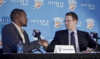 Kevin Durant shakes hands with Thunder general manager Sam Presti during a press conference to officially announce Durant's five year contract extension to play of the Oklahoma City Thunder on Friday, July 9, 2010, in Oklahoma City, Okla. (AP Photo/The Oklahoman, Chris Lansberger)