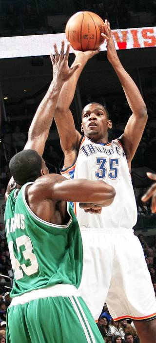 Oklahoma City's Kevin Durant shoots over Boston's Kendrick Perkins during the Celtics' 105-87 win Friday at the Ford Center. PHOTO BY NATE BILLINGS, THE OKLAHOMAN