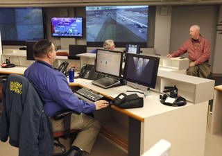 Harry Trottier, foreground, Field Services Southeast Area Coordinator, Gary Longan, Field Services Specialist, center, and Chuck Kerns, Field Services Northest Area Coordinator, facing the camera, are shown in the Emergency Operations Center. PAUL HELLSTERN - Paul Hellstern, The Oklahoman